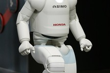 -                Honda Motor Co.'s interactive robot Asimo walks up a set of stairs during at a demonstration event at the Miraikan science museum, in Tokyo, Wednesday, July 3, 2013. The walking, talkin