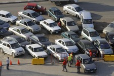 -                FILE - In this Tuesday, June 25, 2013 file photo, Egyptian drivers wait in long queues outside a gasoline station in Cairo, Egypt. Egypt's descent into even deeper political turmoil put