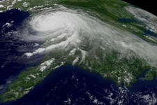 -                FILE - This Aug. 29, 2005 file photo provided by NOAA shows a satellite image of Hurricane Katrina. U.N. climate experts say global warming accelerated since the 1970s, breaking more co
