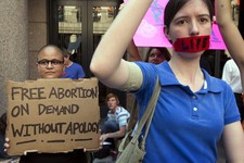 -                Pro-abortion rights supporter Yatzel Sabat, left, and anti-abortion protestor Amanda Reed demonstrate at the state Capitol in Austin, Texas, on Tuesday July 2, 2013.  Gov. Rick Perry ha