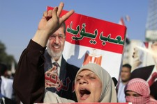 -                Supporters of Egypt's Islamist President Mohammed Morsi chant slogans during a rally, in Nasser City, Cairo, Egypt, Thursday, July 4, 2013. The chief justice of Egypt's Supreme Constitu