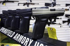 -                In this Wednesday, Jan. 16, 2013 photo, semi-automatic handguns are seen on display at Capitol City Arms Supply in Springfield, Ill. The window for Illinois communities to ban assault w