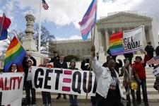 -                FILE - In this March 27, 2013 file photo, demonstrators hold flags and chant in front of the Supreme Court in Washington on the second day of gay marriage cases before the court. The Su