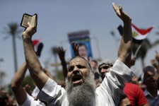 -                Supporters of ousted Egypt's President Mohammed Morsi chant slogans during a protest near the University of Cairo, Giza, Egypt, Friday, July 5, 2013. Egypt's Muslim Brotherhood called f