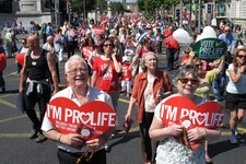 -                Stephen and Pauline O'Brien, foreground, hold Catholic rosary beads as they march through Ireland's capital, Dublin, in an anti-abortion protest Saturday, July 6, 2013. More than 35,000