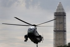 -                In this photo taken May 28, 2013, repairs continue on the Washington Monument as Marine One helicopter comes in for a landing on the South Lawn of the White House in Washington. While t