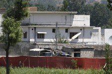 -                FILE - In this May 2, 2011 file photo, a Pakistani soldier stands near a compound where al-Qaida leader Osama bin Laden lived in Abbottabad, Pakistan. Bin Laden was able to live in Paki