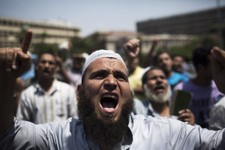 -                Supporters of Egypt's ousted President Mohammed Morsi chant slogans against the military near Cairo University, where protesters have installed their camp in Giza, southwest of Cairo, E