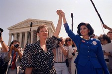 -                FILE - In this Wednesday, April 26, 1989 file photo, Norma McCorvey, Jane Roe in the 1973 court case, left, and her attorney Gloria Allred hold hands as they leave the Supreme Court bui