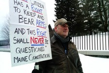 -                Michael Hein of Augusta, Maine, holds a sign in front of the Maine State house during a Gun Appreciation Day rally, Saturday, Jan. 19, 2013.  Rallies are being held by gun rights advoca