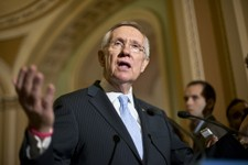 -                Senate Majority Leader Harry Reid of Nev. gestures as he speaks with reporters on Capitol in Washington, Tuesday, July 9, 2013, about student loan rates following a Democratic strategy