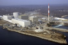 -                FILE - This March 18, 2003 aerial file photo shows the Millstone nuclear power facility in Waterford, Conn. Climate change and extreme weather already are causing disruptions in the U.S