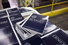 -                FILE - In this April 8, 2013, photo, copies of President Barack Obama's budget plan for fiscal year 2014 are prepared for delivery at the U.S. Government Printing Office in Washington.