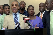 -                FILE- In this July 6, 2012 file photo, the Rev. Al Sharpton, left, speaks in front of Trayvon Martin's parents, father Tracy Martin, background center, and mother Sybrina Fulton, attorn