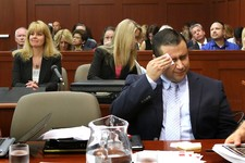 -                George Zimmerman wipes his face after arriving in the courtroom during his trial at the Seminole County Criminal Justice Center, in Sanford, Fla., Friday, July 12, 2013.  Zimmerman is c