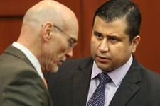 -                George Zimmerman, right, speaks with defense counsel Don West after the jury leaves the courtroom for more deliberations, in the 25th day of his  trial at the Seminole County Criminal J
