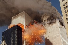 -                FILE- In this September 11, 2001 file photo, smoke billows from World Trade Center Tower 1 and flames explode from Tower 2 as it is struck by American Airlines Flight 175, when terroris