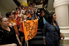 -                Abortion rights advocates protest HB2 from the area outside of the Senate Chamber as anti-abortion rights supporters pass them in the State Capitol in Austin, Texas on Friday night, Jul