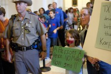 -                Linda Maska and Theresa Maska, 8, hold anti-abortion rights signs outside of the Senate Gallery in the State Capitol in Austin, Texas on Friday, July 12, 2013. The Texas Senate's leader