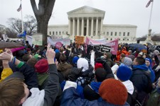 -                FILE - In this Jan. 23, 2012, file photo, anti-abortion and abortion rights supporters stand face to face in front of the Supreme Court in Washington, during the annual March For Life r