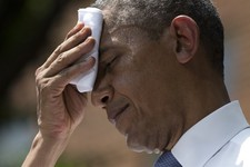 -                FILE - In this June 25, 2013, file photo President Barack Obama wipes perspiration from his brow during an ambitious speech about climate change under a steaming hot sun at Georgetown U