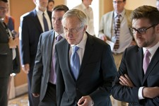 -                Senate Majority Leader Harry Reid, D-Nev., center, walks to closed-door meeting in the Old Senate Chamber for a showdown over presidential nominees that have been blocked by a GOP filib