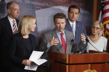 -                Sen. Rand Paul, R-Ky., center, speaks to reporters during a news conference about a bill regarding military sexual assault cases on Capitol Hill in Washington, Tuesday, July 16, 2013. A