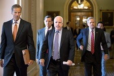 -                Republican senators, from left, Sen. John Thune, R-S.D., Sen. John Barrasso, R-Wyo., Sen. John McCain, R-Ariz., and Sen. John Hoeven, R-N.D., walk from the floor to a closed-door caucus