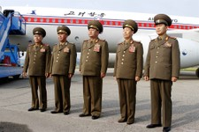 -                In this Wednesday, June 26, 2013 photo, North Korea's military delegation members led by chief of the General Staff of the people's army, Kim Kyok Sik , center, pose for photos before l