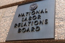 -                The sign for the National Labor Relations Board is seen on the building that houses their headquarters in downtown Washington, Wednesday, July 17, 2013. For such a tiny government agenc