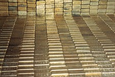 -                FILE - In a Sept. 24, 1974 file photo gold bars are seen at the U.S. Depository in Ft. Knox, Ky.  A new study based on observations from space suggests the gold on Earth came from colli