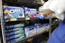-                FILE - In this July 28, 2008 file photo, a worker fixes the display of Oreo cookies at a market in Palo Alto, Calif. Activist investor Nelson Peltz says he wants soda-and-snack food gia