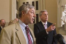 -                Rep. Fred Upton, R-Mich., left, chairman of the Committee on Energy and Commerce, and House Majority Whip Kevin McCarthy, R-Calif., right, speak to reporters just before a vote to delay