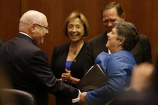 -                Homeland Security Secretary Janet Napolitano, right, laughs with University of California president Mark Yudof, left, following a University of California Board of Regents meeting Thurs