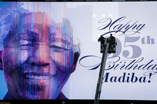 -                An electronic billboard announces Nelson Mandela's 95th birthday in New York's Times Square, Thursday, July 18, 2013. South Africa celebrated Nelson Mandela's 95th birthday on Thursday,