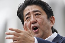 -                FILE - In this July 4, 2013 file photo, Japanese Prime Minister Shinzo Abe delivers a speech during an upper house election campaign rally in Tokyo. With the economy perking up under hi