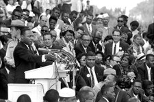 "-                FILE - In this Aug. 28, 1963 file photo, the Rev. Dr. Martin Luther King Jr., head of the Southern Christian Leadership Conference, speaks to thousands during his ""I Have a Dream"" speec"