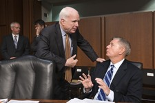 -                Sen. John McCain, R-Ariz., center, and Sen. Lindsey Graham, R-S.C., right, confer at the start of a Senate Armed Services Committee hearing on the reappointment of Gen. Martin Dempsey,
