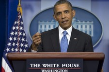 -                President Barack Obama gestures as he speaks during his daily news briefing at the White House, Friday, July 19, 2013, in Washington, about the fatal shooting of Trayvon Martin by Georg