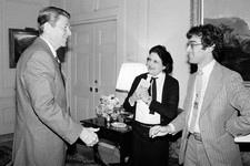 -                FILE - In this April 13, 1981, file photo, President Ronald Reagan greets UPI reporter Helen Thomas, center, and AP reporter Jim Gerstenzang, right, before an interview in the Treaty Ro