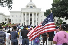 "-                People gather  in front of the Alabama Capitol during a rally, Saturday, July 20, 2013, in Montgomery, Ala. The Rev. Al Sharpton's National Action Network organized ""Justice for Trayvon"