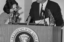 -                FILE - In this May 12, 1963, file photo, reporter Helen Thomas asks President John F. Kennedy for copies of his announcement pledging Federal power to preserve order and lives in Birmin