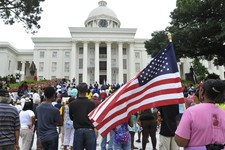 "-                People gather in front of the Capitol during a rally, Saturday, July 20, 2013, in Montgomery, Ala. The Rev. Al Sharpton's National Action Network organized ""Justice for Trayvon"" rallies"
