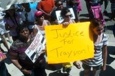 "-                Kyla Ashbaker of Flint, 10, holds a sign that reads, ""Justice for Trayvon!"" among about 200 people, who gather along with representatives from the Flint chapter of the Rev. Al Sharpton'"