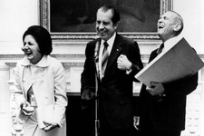 -                FILE - In this Sept. 30, 1971, file photo, President Richard Nixon laughs with UPI reporter Helen Thomas, left, and AP reporter Douglas Cornell during an impromptu reception in Washingt