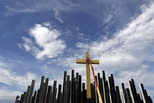 -                Workers prepare a cross on the stage where Pope Francis will deliver mass next week in Guaratiba, some 40 km. south of Rio de Janeiro, Brazil, Sunday July 21, 2013. Pope Francis, the 76