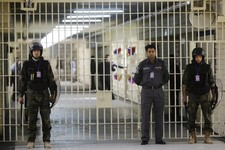 -                FILE - In this Feb. 21, 2009 file photo, guards stand at a cell block at the renovated Abu Ghraib prison, now renamed Baghdad Central Prison and run by Iraqis in Baghdad, Iraq. Late-nig