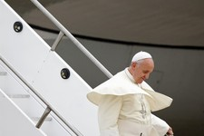 -                Pope Francis deplanes upon his arrival at the international airport in Rio de Janeiro, Brazil, Monday, July 22, 2013. During his seven-day visit, Francis will meet with legions of young