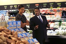 "-                First lady Michelle Obama walks through Sterling Farms Grocery Store with actor Wendell Pierce, who opened the store last year as part of the ""Alliance For A Healthier Generation,"" Tues"