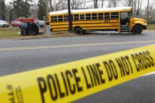 -                FILE - This Feb. 16, 2012 file photo shows investigators viewing the scene of a school bus crash in Chesterfield, N.J. Federal investigators are expected to make new school bus safety r